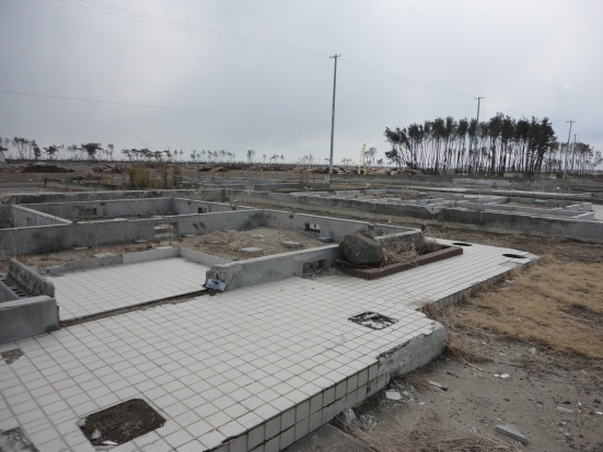 What used to be the town of Natori, just south of Sendai Airport,north east coast. This photograph was taken in April 2012, just after the first anniversary near the mouth of the Natorigawa (Natori River) which carried the tsunami so far inland