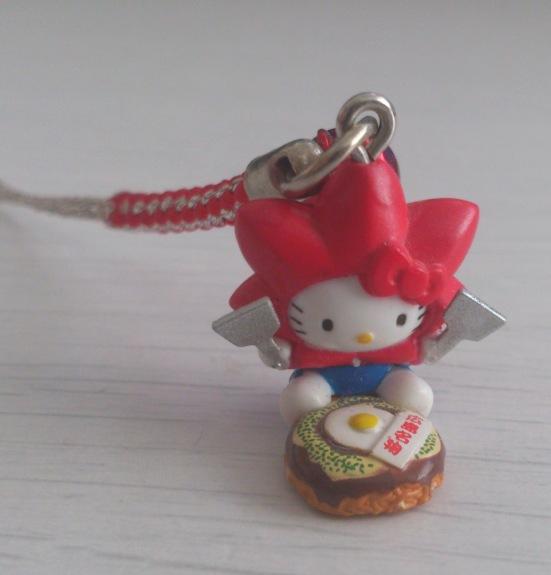 Hiroshima Hello Kitty, with momiji head, eating okonomiyaki