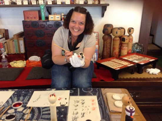 Me, painting a kokeshi doll in Naruko Onsen, May 2014