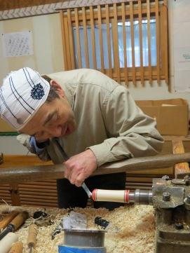 Naruko craftsman making kokeshi